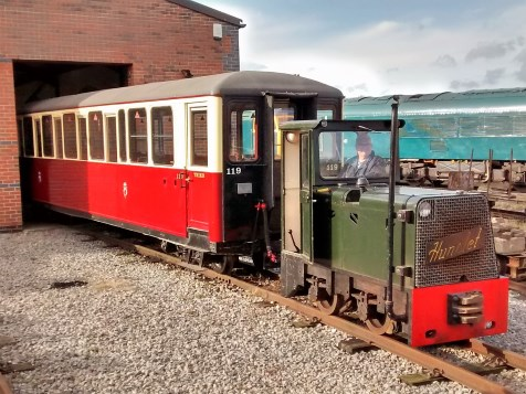 image:- Carriage 119 hauled by AD34, leaving the Running Shed