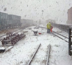 image:- trackwork at Butterley Park Station covered in snow.